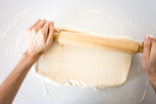 Roll out the croissant dough into a large rectangle.