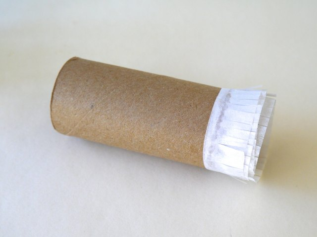 Wrap the white strip around the toilet paper roll.