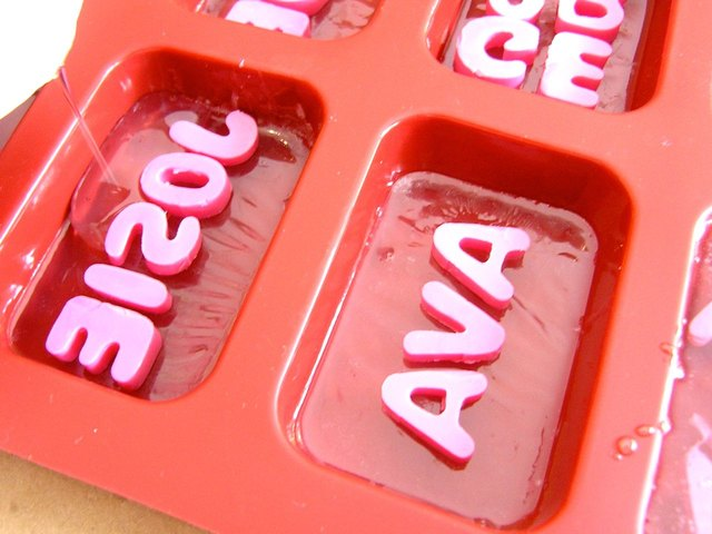 Pour more clear soap over the letters.