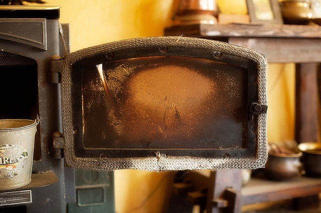 How to Clean the Glass Door of a Wood Stove - How To Clean The Glass Door Of A Wood Stove (with Pictures) EHow