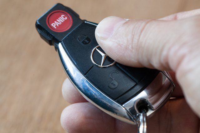 How to replace the car key battery in a mercedes benz ehow for Mercedes benz replacement keys
