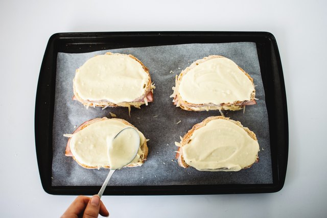 Cover the sandwiches with remaining bechamel sauce.