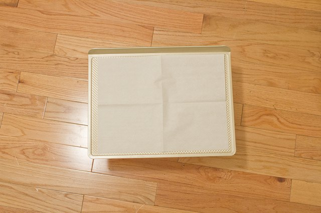 Unfold your parchment paper onto the cookie sheet.