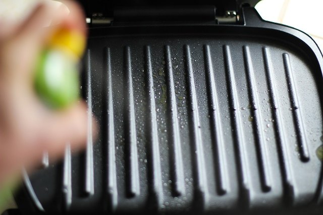 Coat the grill's surface with cooking spray.