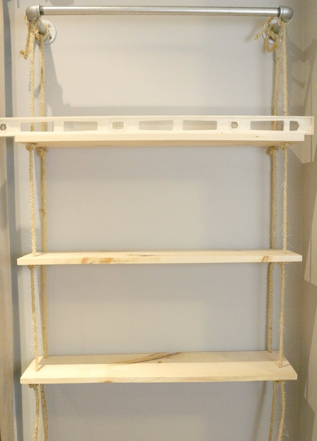 Level and tie on the other two shelves.