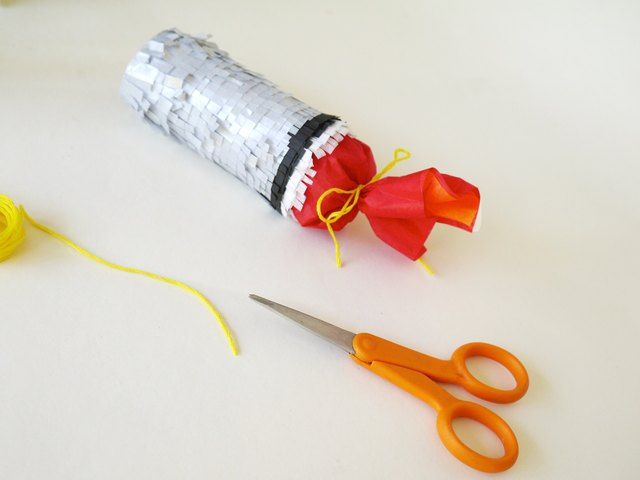 Tie the tissue with embroidery floss.