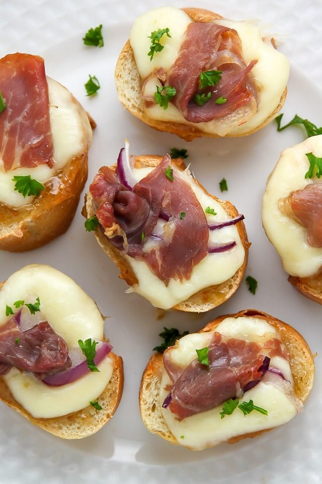 Crispy bread topped with fig and prosciutto makes a lovely appetizer ...