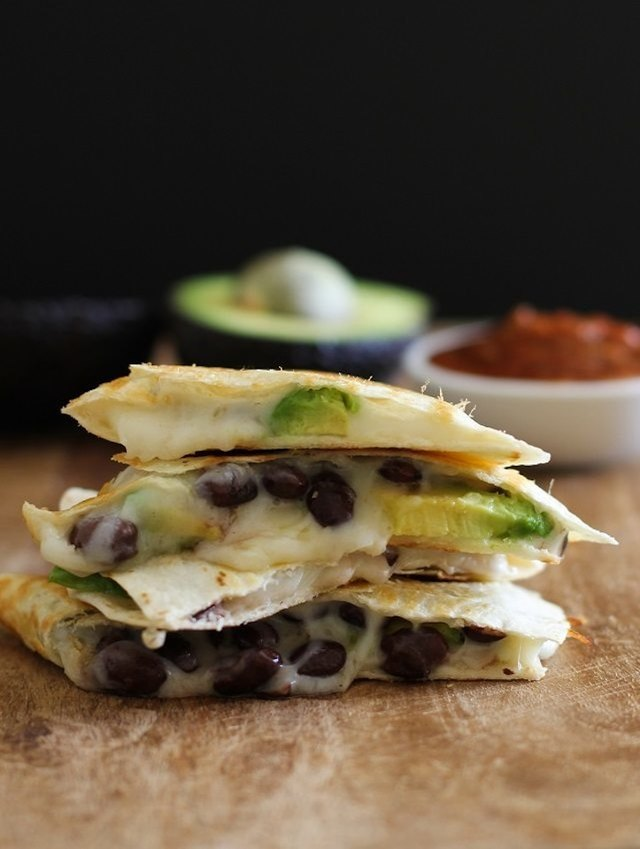 Add avocado and black beans to your quesadillas.