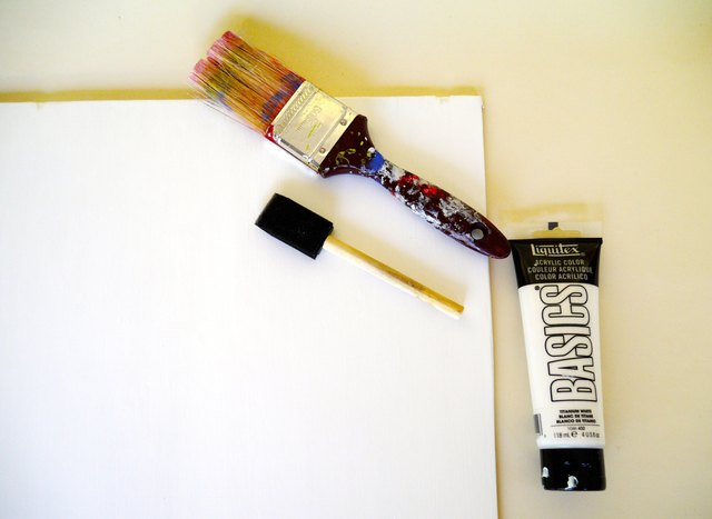 Paint the plywood's primed side with three coats of acrylic paint.