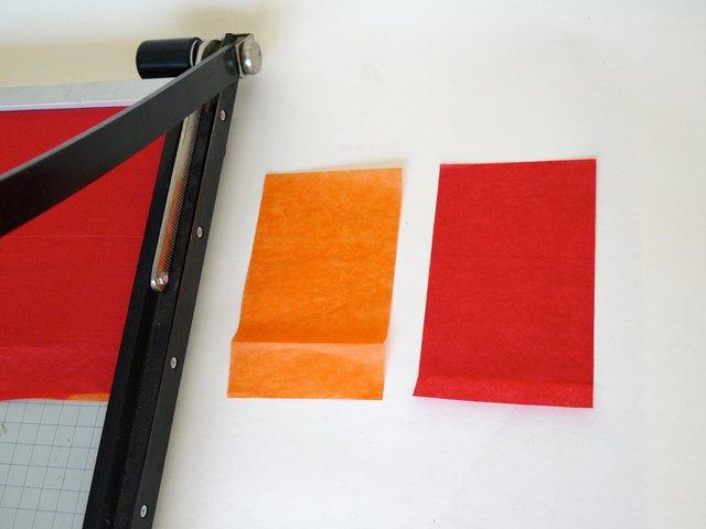 Trim red and orange tissue into 3-by-6 inch rectangles.