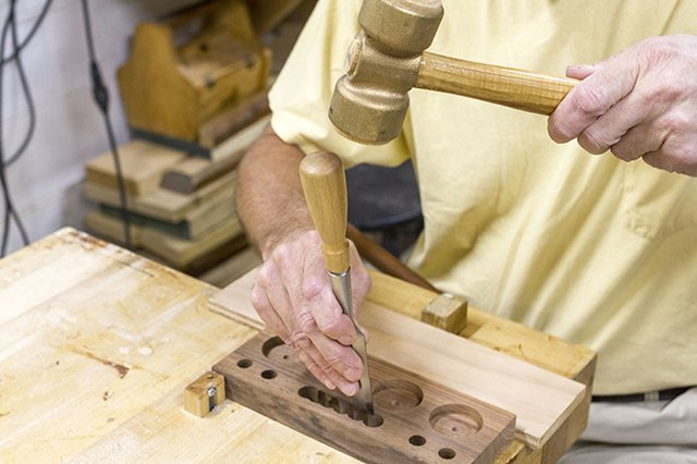 Use a socket chisel and wooden mallet to clean out excess wood from the phone slot.