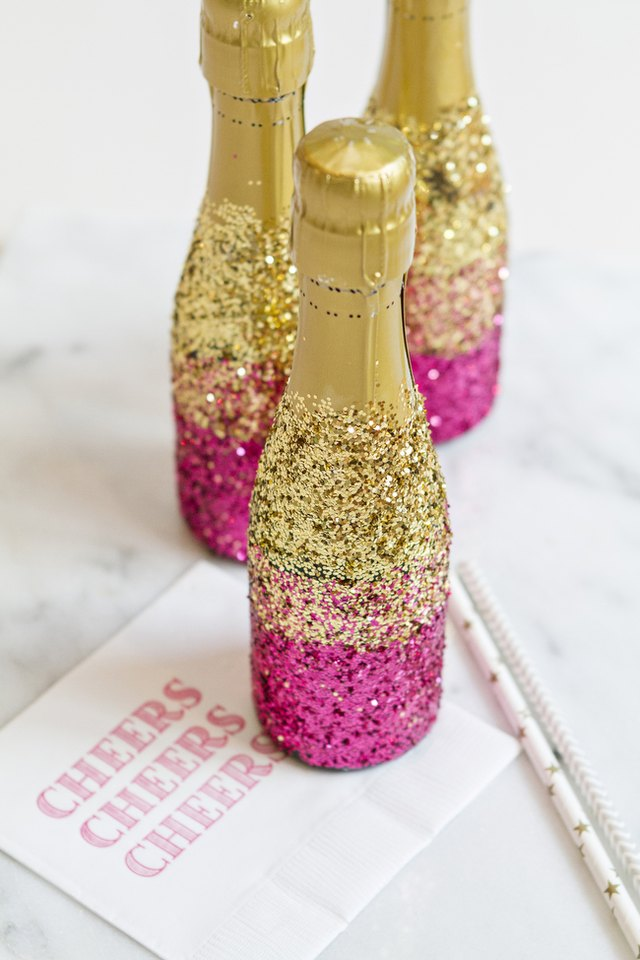 How To Decorate Mini Champagne Bottles With Glitter EHow