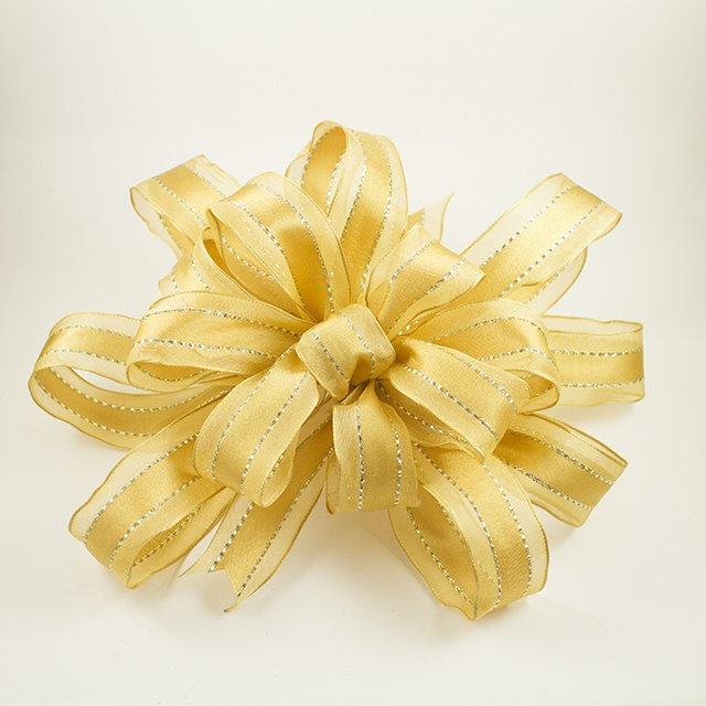 how to make decorative big yellow ribbon bows ehow. Black Bedroom Furniture Sets. Home Design Ideas
