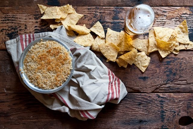 This jalapeño popper beer cheese dip pairs well with tortilla chips and a crisp beer.