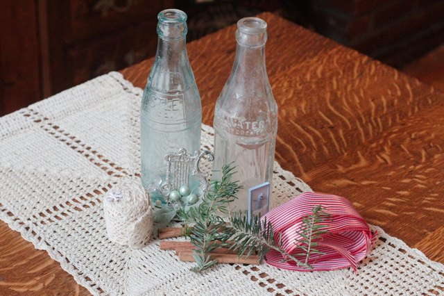 How to make christmas empty glass bottle decorations ehow for Empty bottle decoration ideas
