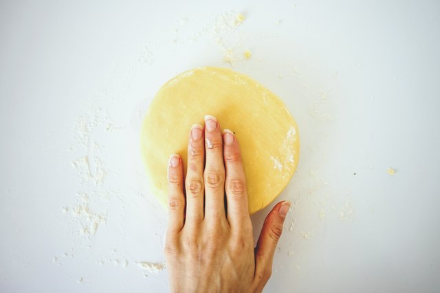 Flatten the dough into a disc before wrapping in plastic and chilling for at least 30 minutes.