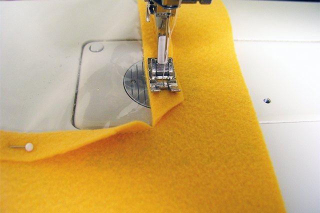 Pull slightly as you stitch since the vinyl has a tendency to stick to the throat of the sewing machine.