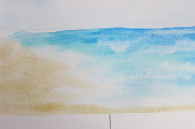 Use a very diluted Raw Sienna for the sand.