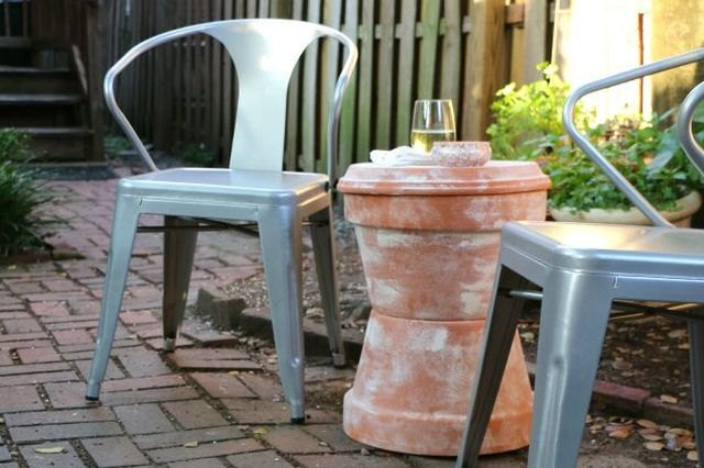 Stack pots bottom to bottom for a simple side table.