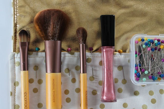Place makeup brushes and pin sections.