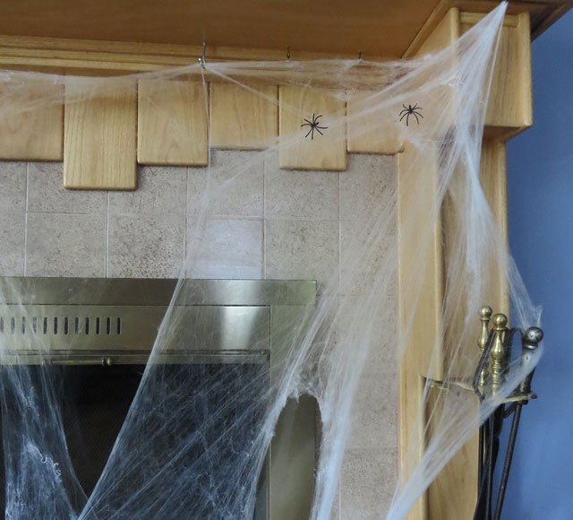 How to decorate with fake spider webbing.