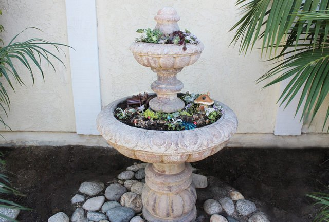 Turn a broken or unused fountain into a tiered planter.