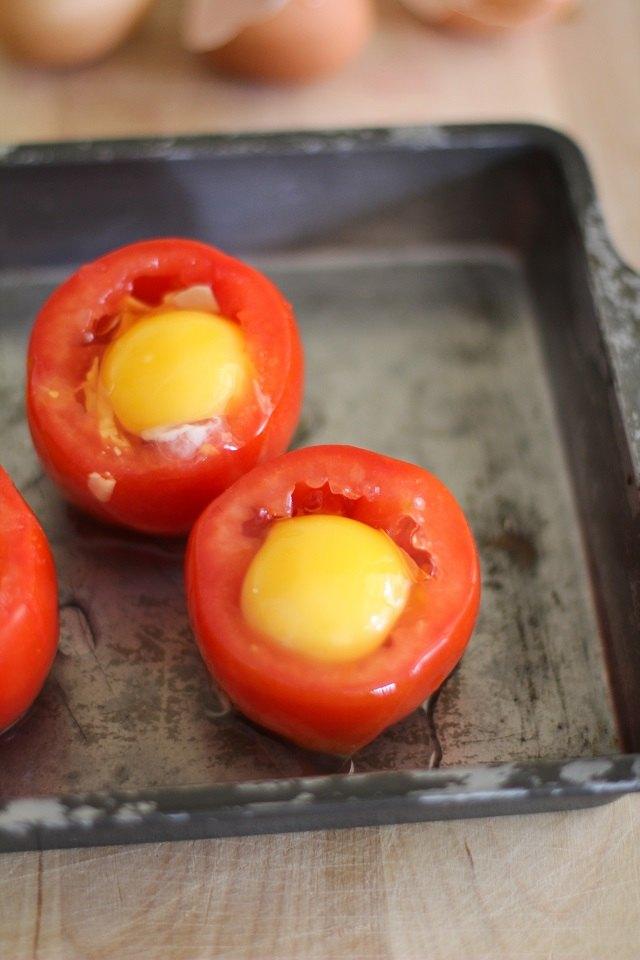 Crack an egg into each tomato.