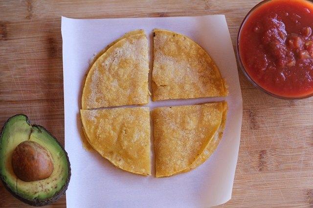 Chop quesadilla on a cutting board.