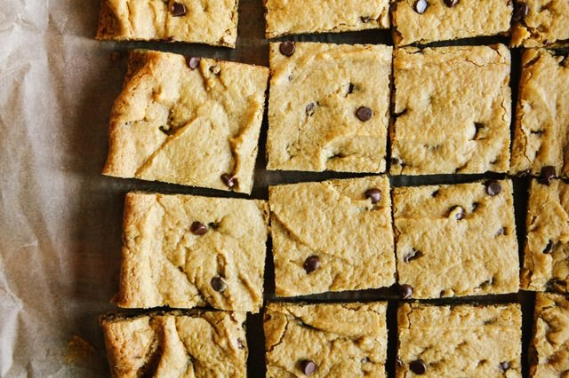 Enjoy a pumpkin chocolate chip cookie bar with a glass of milk.
