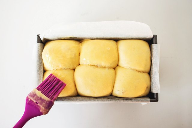 Brush the risen loaf with the egg wash.
