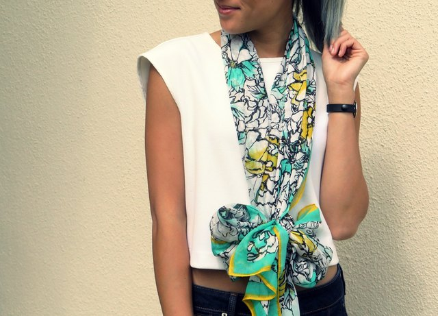 A bow scarf adds a little whimsy to your look.