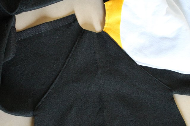Sew the sleeve to the body at the shoulder seam.