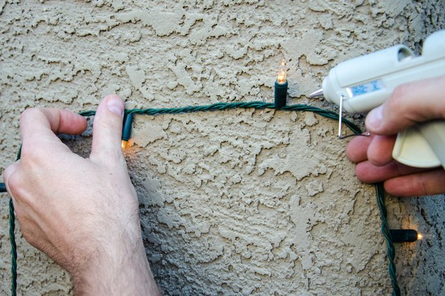 Christmas Lights On Concrete Wall : How to Hang Christmas Lights on Stucco (with Pictures) eHow