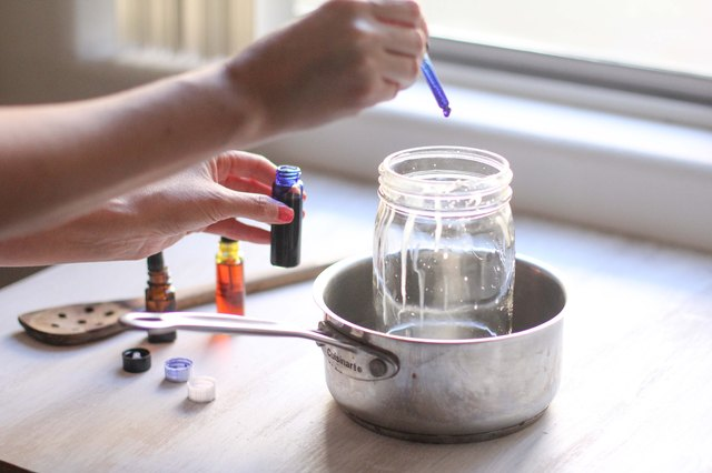 Add liquid dye and essential oil to the melted wax.