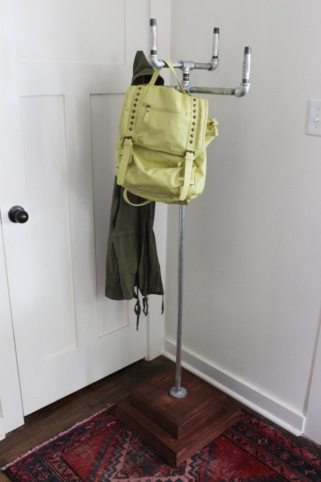 Use pipe to create an industrial coat rack.