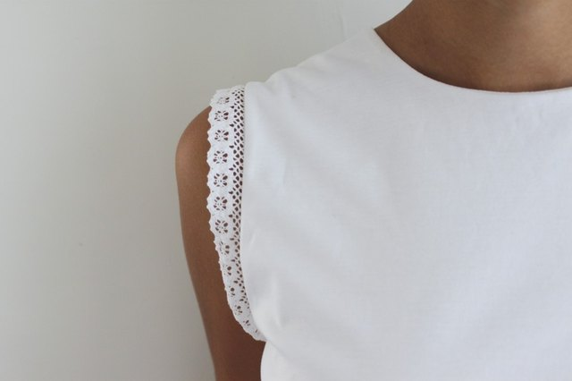 Lace trim adds a feminine touch to the standard tank top.