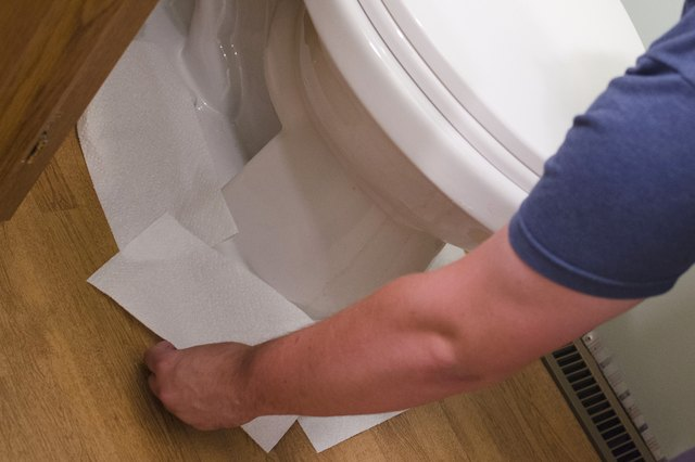 how to fix an overflowing toilet without a plunger