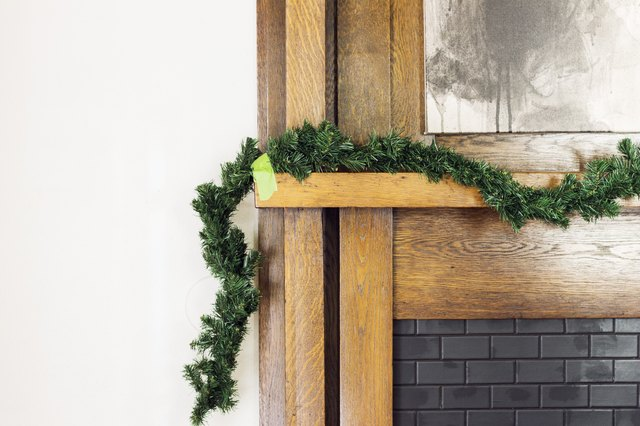Use tape to play around with the shape of the garland.