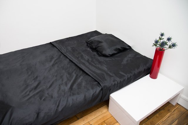 how to wash satin sheets with pictures ehow. Black Bedroom Furniture Sets. Home Design Ideas