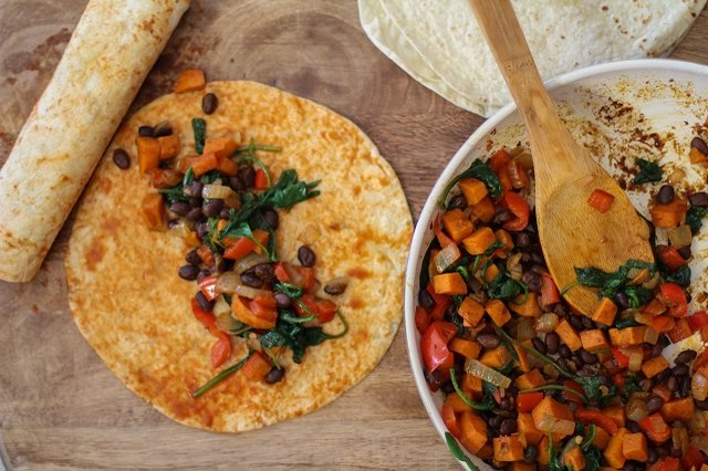 Fill the tortillas with sauteed vegetables.