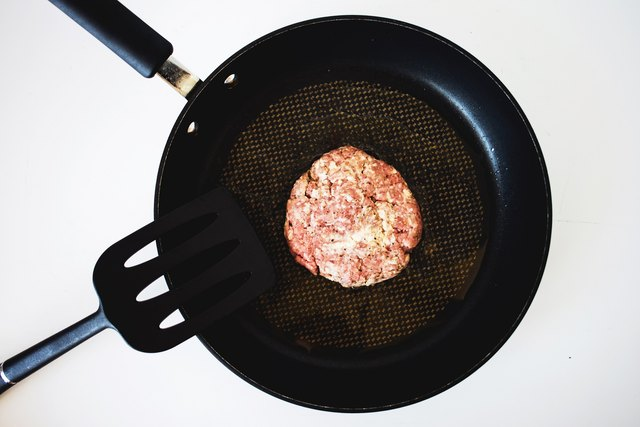 Fry the beef hamburger patties on each side.