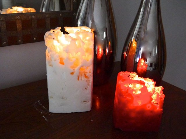 These lit ice candles add romance to a room.