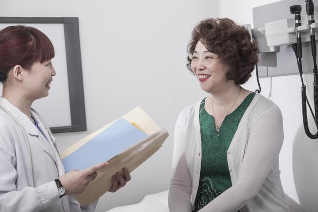 Woman speaking with her doctor in office