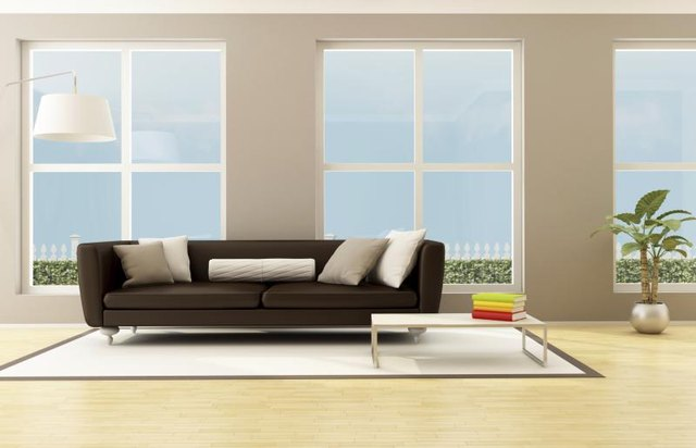 Neutrals of gray and white pair seamlessly with brown leather furniture.