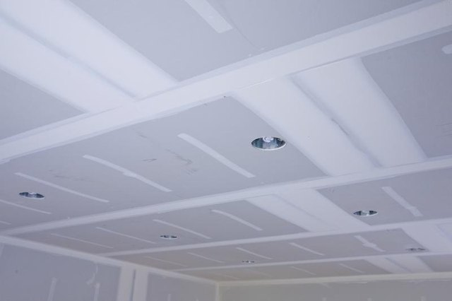 Ceiling with recently installed drywall.