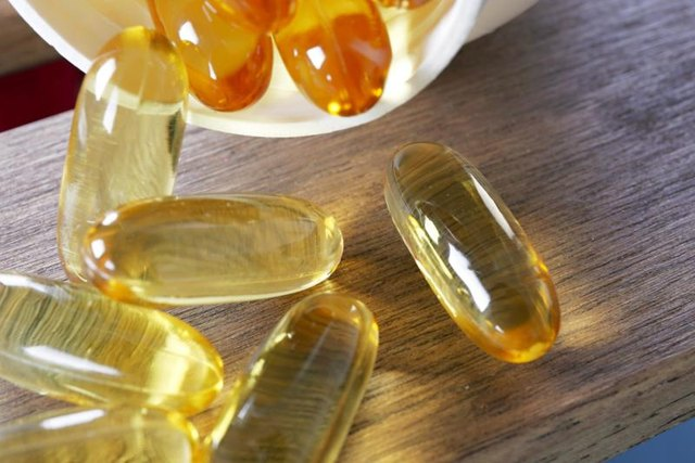 A close-up of fish oil capsules.