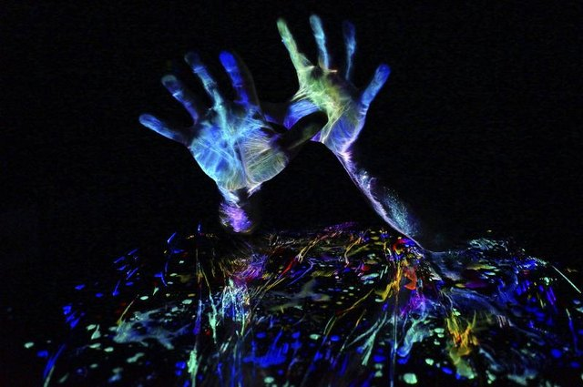 You can also use UV-reactive body paint to light up your clothes in the dark.