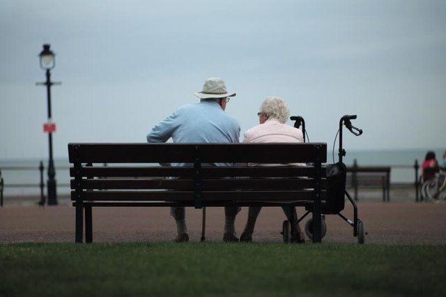 Senior citizens relax on bench