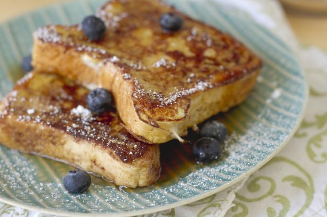 Plate of French toast with blueberries.