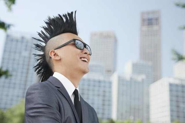 A mohawk adds a daring hairstyle to a 1980s costume.